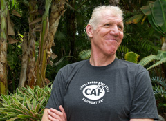 bill walton smiling and looking away from the camera